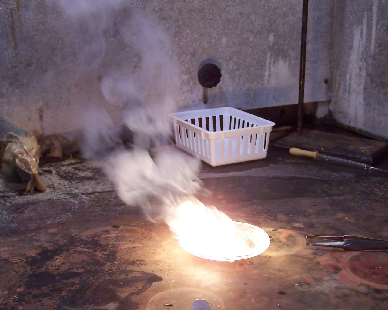 The following pictures show a chunk of phosphorus which has been lit