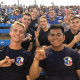 Cadets showing Ram Handsign at football game.
