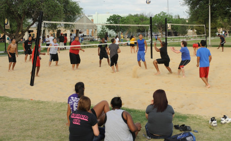 ASU students playing sand volleyball.