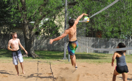 ASU student playing sand volleyball.