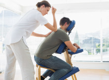 Man receiving massage from physiotherapist
