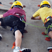 Camp UREC participants climb tethered together.