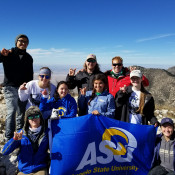 Students from Outdoor Adventures' Experiential Leadership Course pose at the top of Guadalupe Peak.