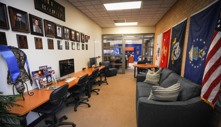 The Hall of Honor and flags of the different branches of service in the VETS Center at Angelo State University.