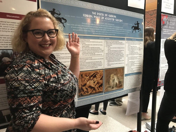 Emily Krause with her poster at the GPHC