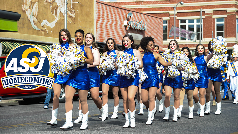 Cheerleaders in the homecoming parade and the homecoming logo