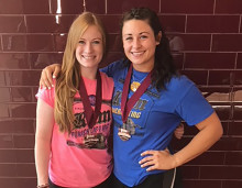(L to R) Caitlin Buck and Brittney Barksdale model their medals from the national meet.