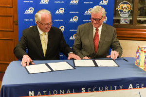 ASU President Brian May (left) and NCS Commandant Leonard Reinsfelder signed the articulation agr...