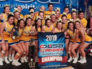Angelo State Cheer Team with 2019 national championship banner