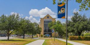 Angelo State banner in front of Centennial Village residence hall