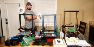Angelo State mechanical engineering student Alan Backlund displays his 3-D printers and supplies
