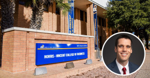Angelo State Norris-Vincent College of Business sign with inset portrait of Dr. Michael Conklin