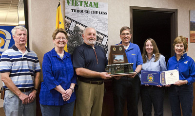 "For their efforts on the ""Vietnam: Through the Lens"" exhibit and on behalf of the local U.S.A. Vietnam War Commemorative Partnership, Sturm and several other ASU Library staff received an award from Tom Nurre Sr., partnership chair."