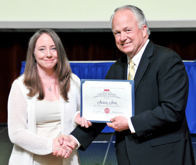 Shannon Sturm receives the 2014–15 Chancellor's Colonel Rowan Award from ASU President Brian J. May.