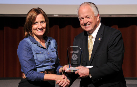 Receives her 2014–15 Staff Excellence Award from ASU President Brian J. May