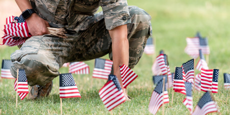 An ASU veteran student plants flags on campus for the annual 9-11 Memorial.