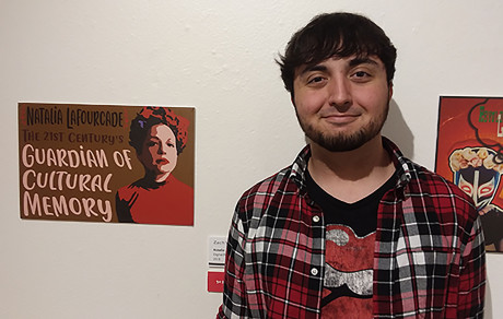 Zachary Vigil-Minyard with his winning print Natalia