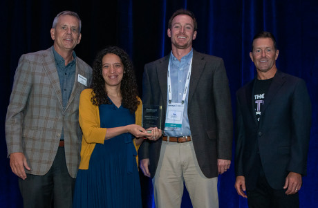 Rebecca Schkade and Brian Jackson (center) of the ASU E-Learning Team with their Catalyst Award -...