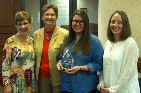 (L to R) Carol Hutson, Suzanne Campbell, Brittany Wollman and Shannon Sturm of the West Texas Collection with the 2016 Archival Award of Excellence.
