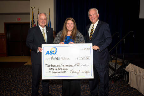 Amanda Ritchie receives her Rodgers Award from Gary Rodgers (right) and ASU President Brian J. May