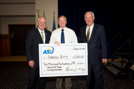 Dr. Bradley Petty receives his Rodgers Award from Gary Rodgers (right) and ASU President Brian J. May (left)