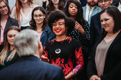Destiny Brown (center) and her classmates meeting with Texas Gov. Gregg Abbot (foreground) on a c...