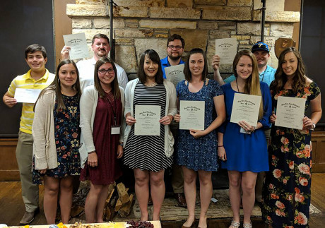ASU Tri-Beta members with their awards certificates at the 2018 national meeting.