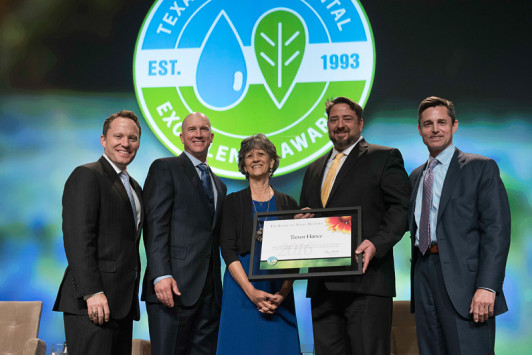 Accompanied by Principal Jan Richards and three TCEQ commissioners, Laurel Mountain Elementary School teacher Trevor Hance, an ASU alum, accepts the 2016 Texas Environmental Excellence Award in the individual category.