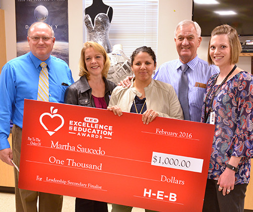 Representatives from HEB surprised Saucedo in her Brady High School classroom to present her with the HEB Excellence in Education Award for leadership in secondary schools. The award included a $10,000 check for Saucedo and a $10,000 grant for her school.