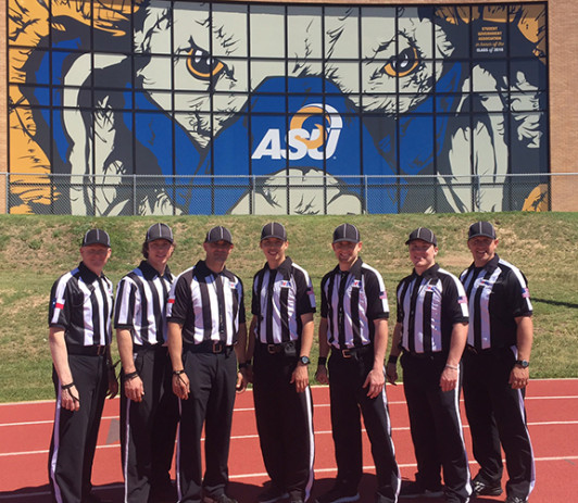 Petty (left) with a group of local high school officials who began their officiating with ASU intramural sports.