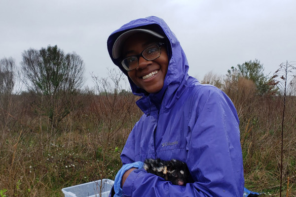 Kamren Jefferson and one of her research subjects in the field