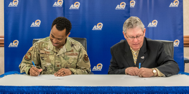 Maj. Michael Quinn and Dr. Don Topliff sign the new transfer MOU.
