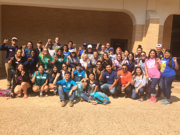 Barker and Mendez (front center) with the group of students volunteering for Students Who Serve: Turn It Gold.