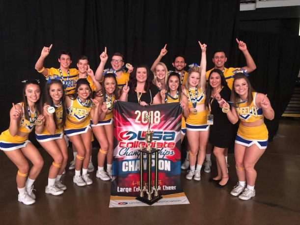 The 2018 Angelo State Cheer Team with their national championship trophy in Anaheim, Calif.