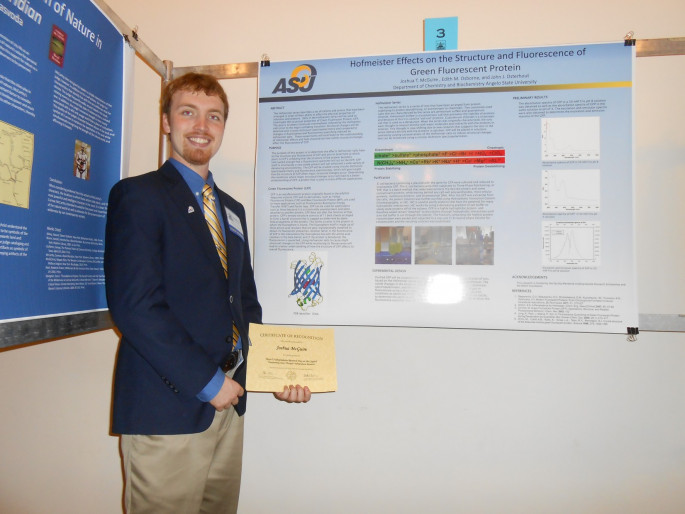 Joshua McGuire presents his research at the Capitol in Austin.