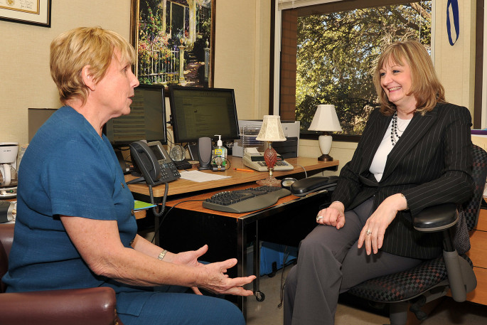 Dr. Karen Shumway (right) in her office with Dr. Carol Diminnie