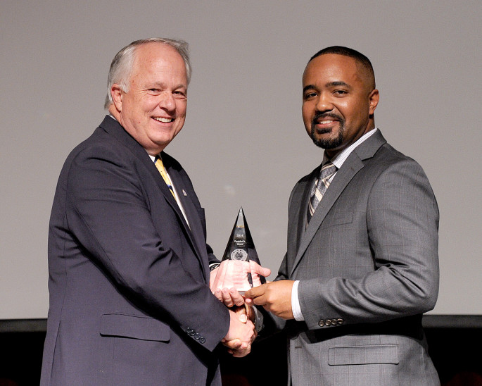 Dr. Alaric Williams (right) receives his Faculty Excellence Award from ASU President Brian J. May.
