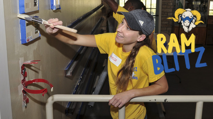 Vanessa Meyer, a junior from San Angelo, helped paint a wall in the Girl Scouts Service Center as part of ASU's Ram Blit...
