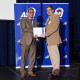Dr. Fortin receiving his 20-year staff service award from Dr. Javier Flores, vice president for S...
