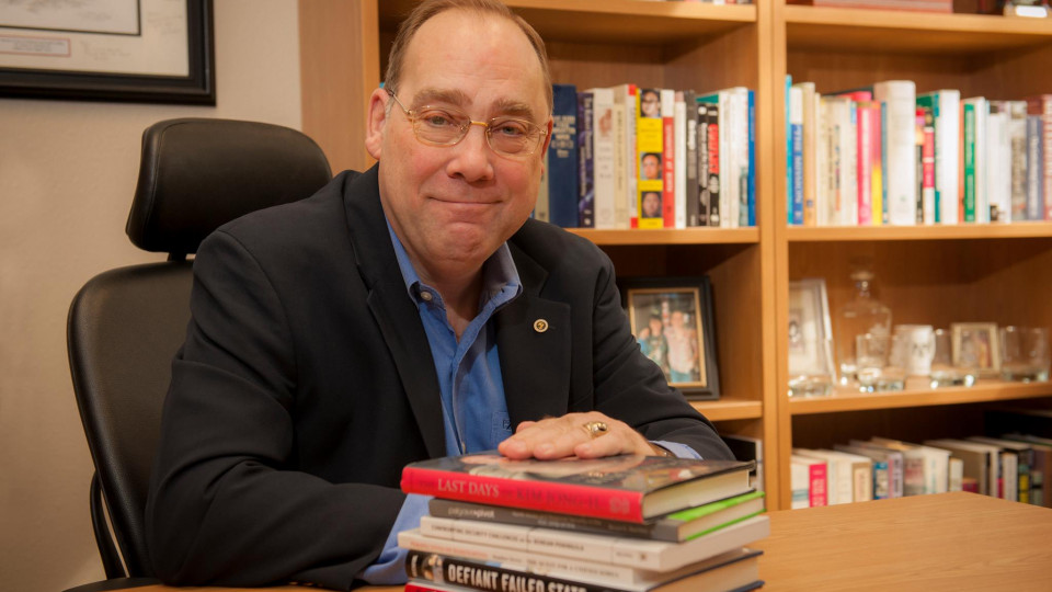 Dr. Bruce Bechtol with books he has written