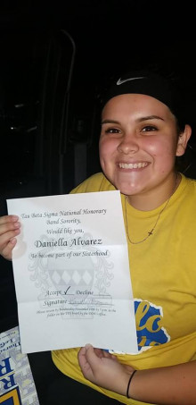 Daniella Alvarez accepting a formal invitation to join the National Honorary Band Sorority.