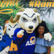 Student posing with Roscoe the Ram.