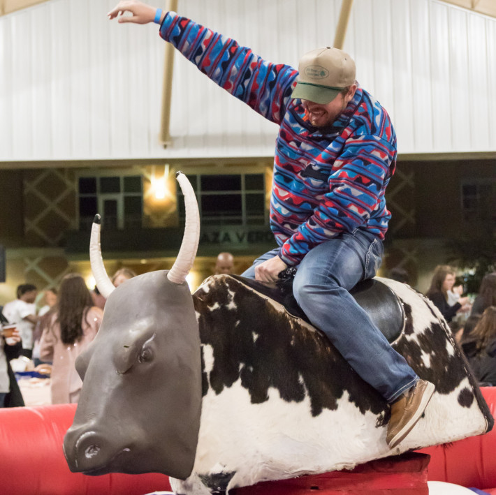 Student riding Mechanical Bull