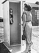 Ruth Shipley, chief operator in Garland, TX, examines one of the wooden phone booths in her area.