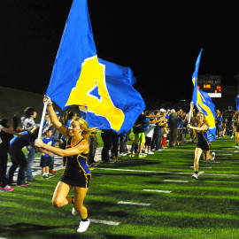 Cheerleaders holding ASU flags, leading the Victory Line