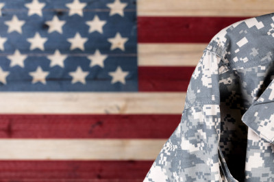 Soldier in front of American Flag