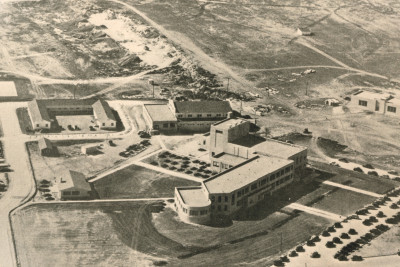 The original buildings at Angelo State University were surrounded by undeveloped land.