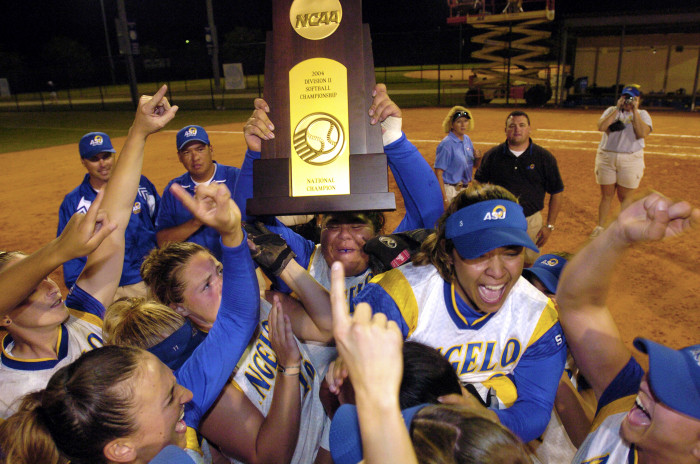 2004 Rambelles Softball Team holding National Champion Trophy