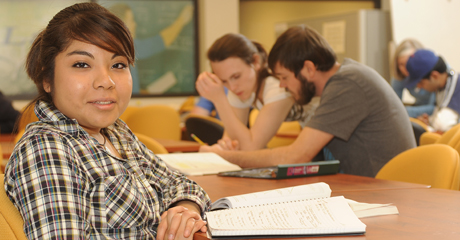 A student works on her scholarship application essays to get them completed in time.
