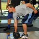 Student lifting a weight.
